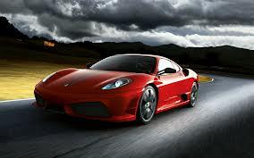 a red Ferrari (hdw.eve-64.com)
